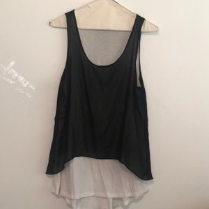 White tank with black sheer covering